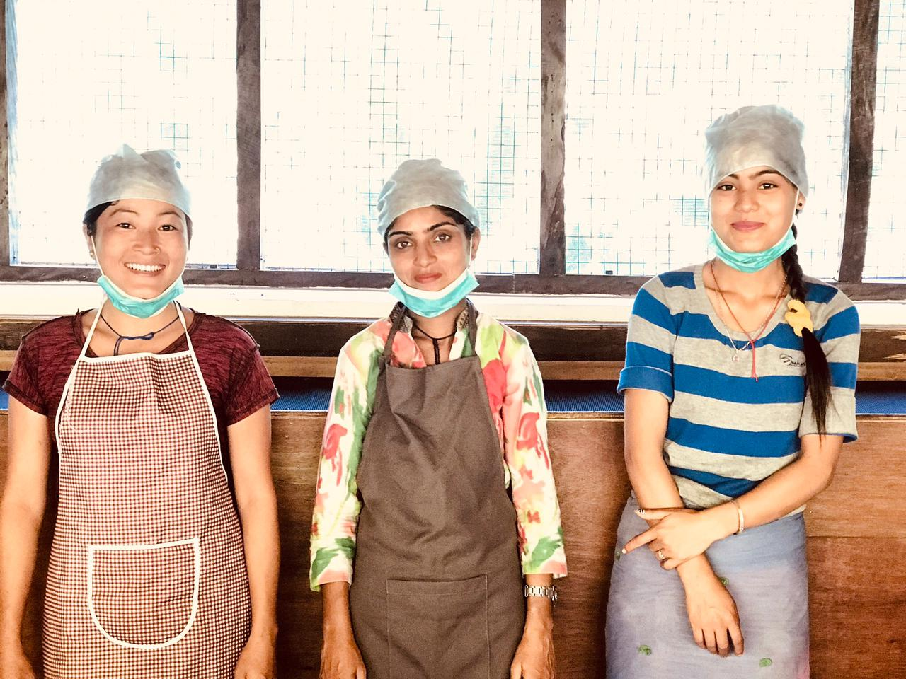 Kalpana (first on the left) with her team at the tea factory